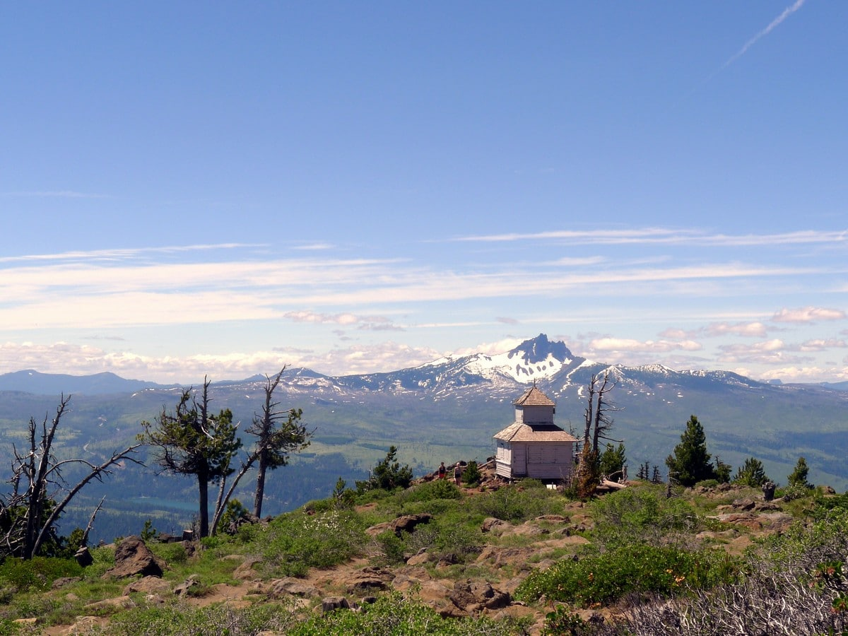 Historic shack with Mt Washington in the background on the Black Butte Hike near Bend, Oregon