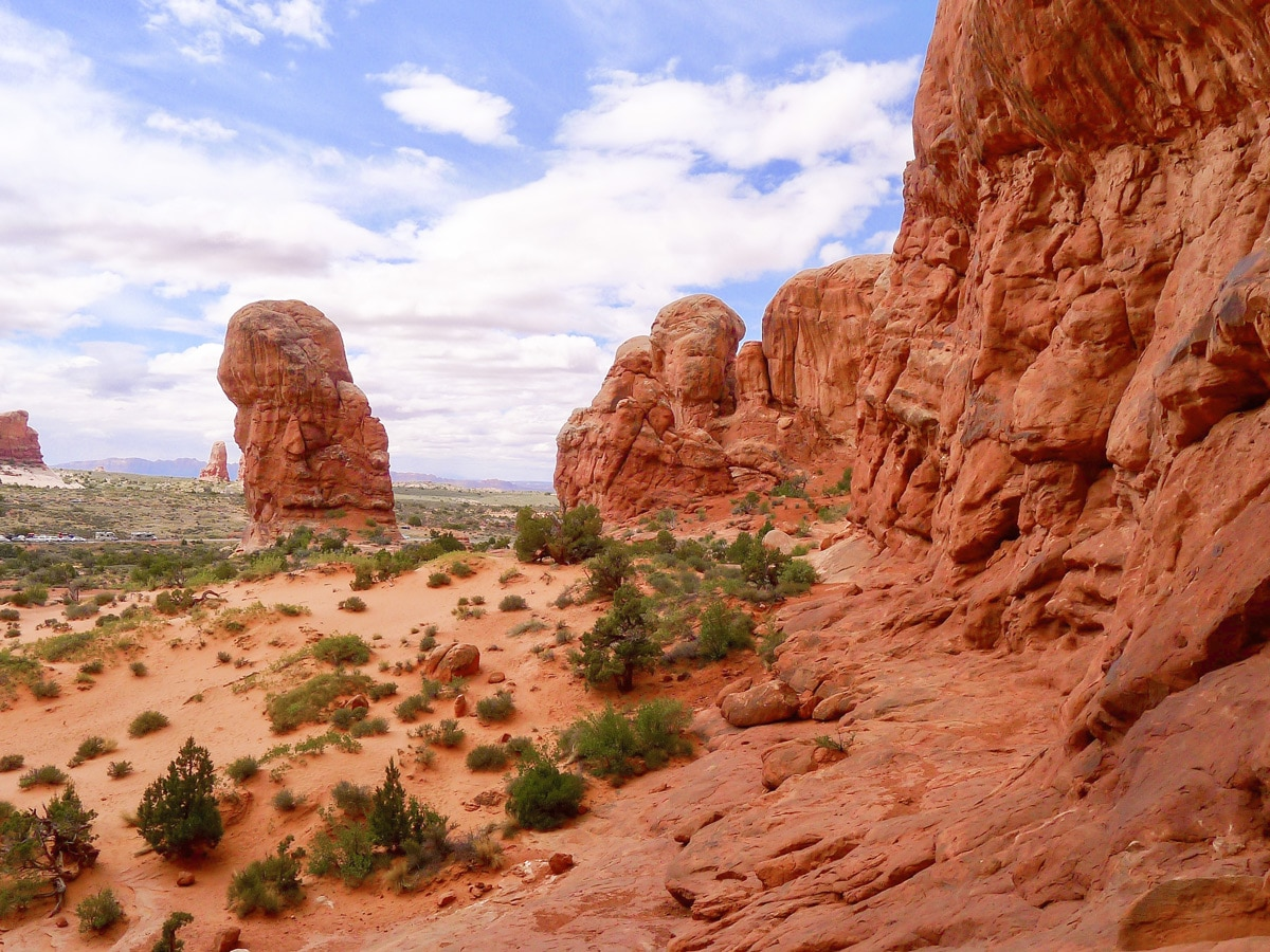 Delicate Arch hike in Arches National Park is surrounded by beautiful cliffs
