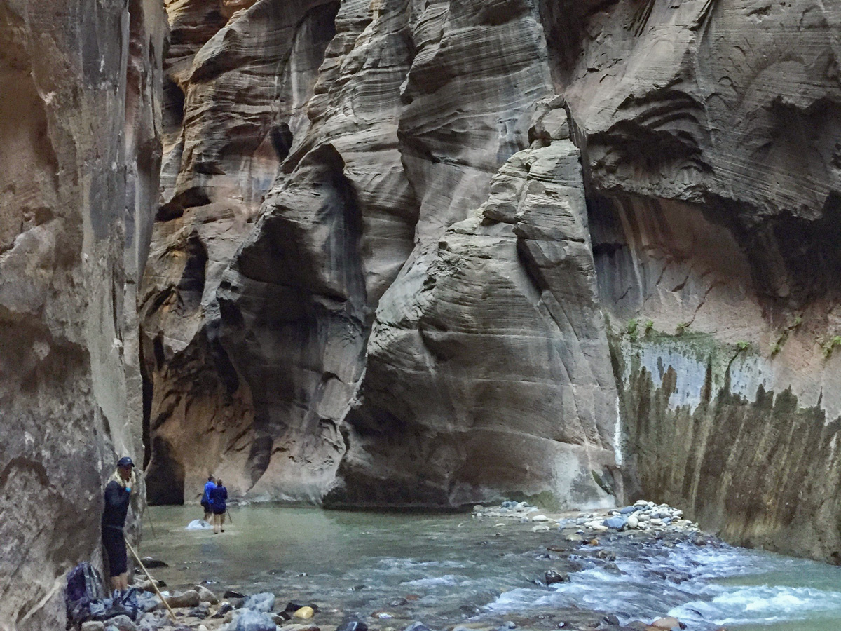 Narrows hike in Zion National Park leads through beautiful blue water