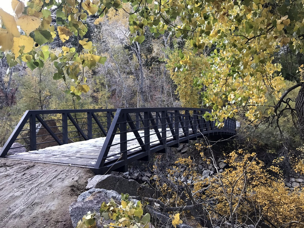 Crossing the wild river on the Creek Canyon trail in Boulder, Colorado