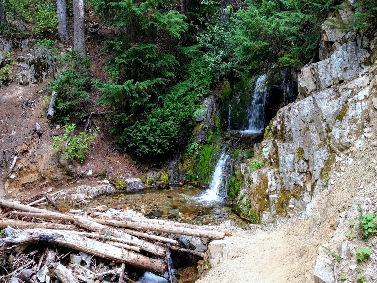 A small waterfall over the trail on the Cutthroat Pass Hike in North Cascades National Park, Washington