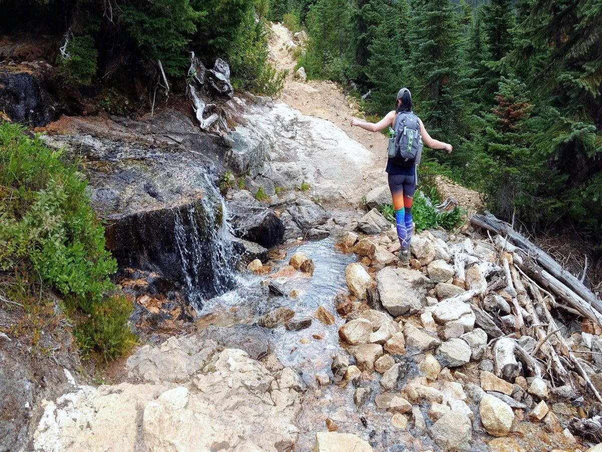 Crossing the creek on the Cutthroat Pass Hike in North Cascades National Park, Washington