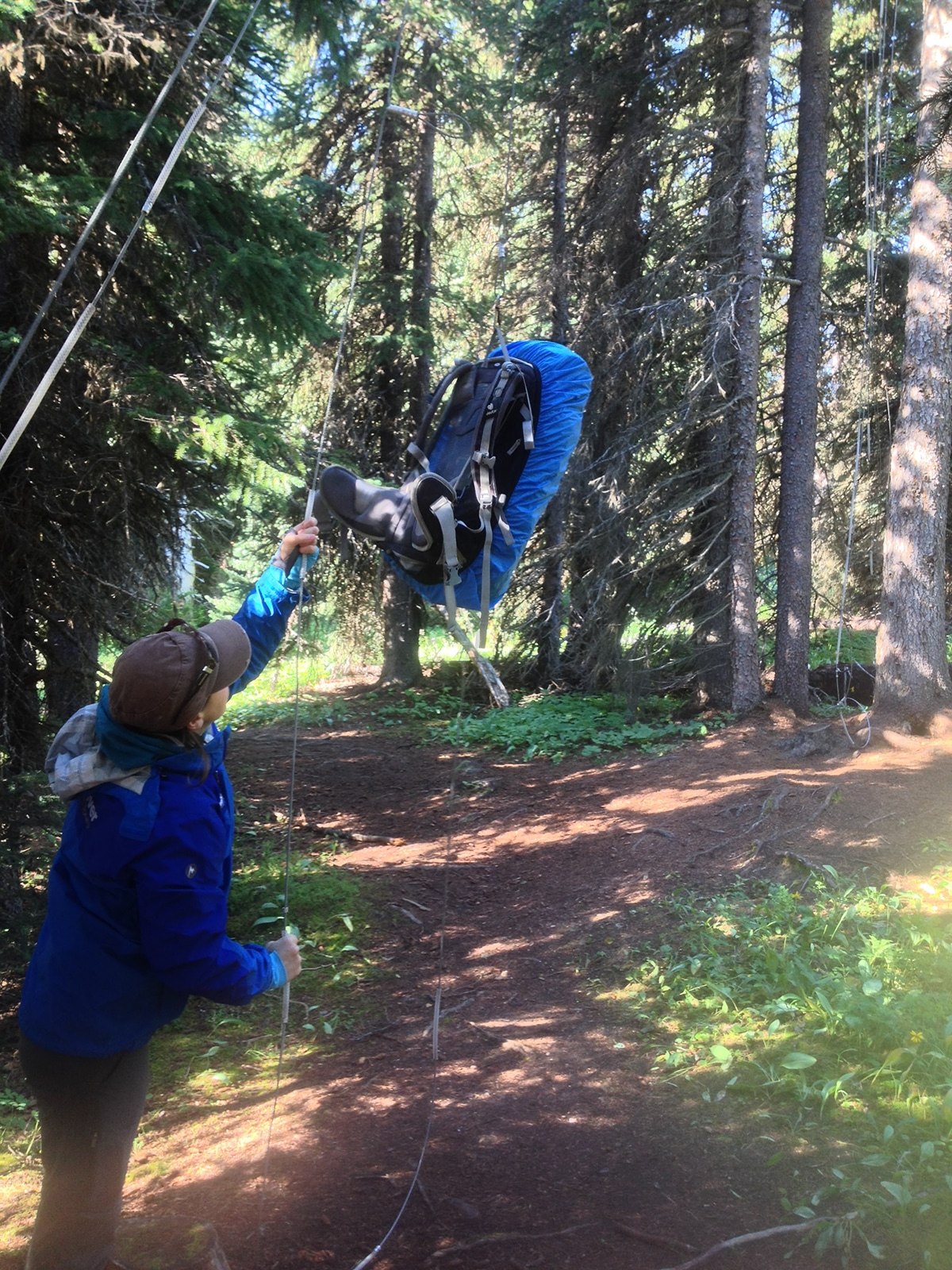 Using a bear hang is a must in lots of national parks for backpackers