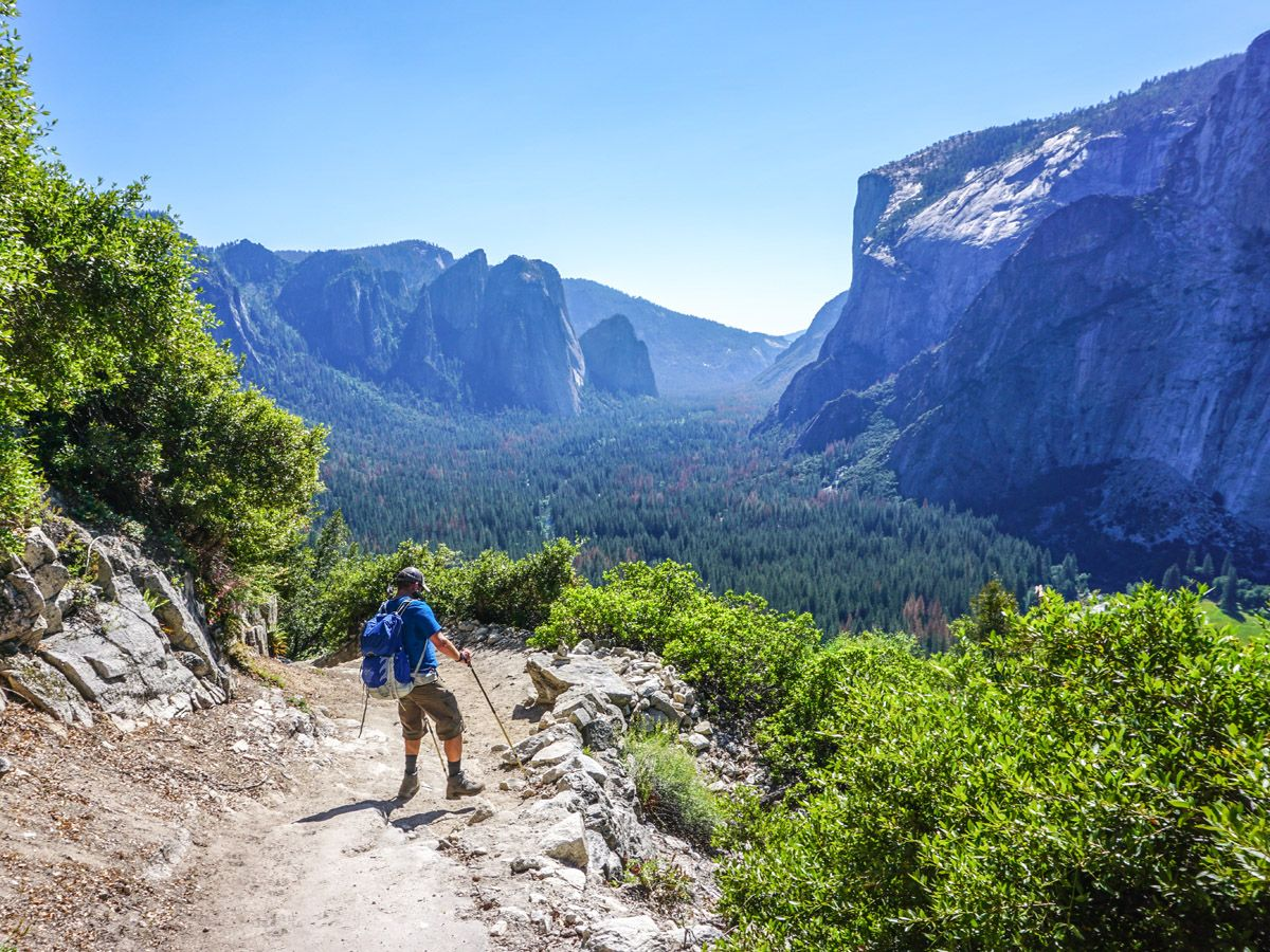Hiker and beautiful views on Yosemite Boot Route trail in Yosemite National Park
