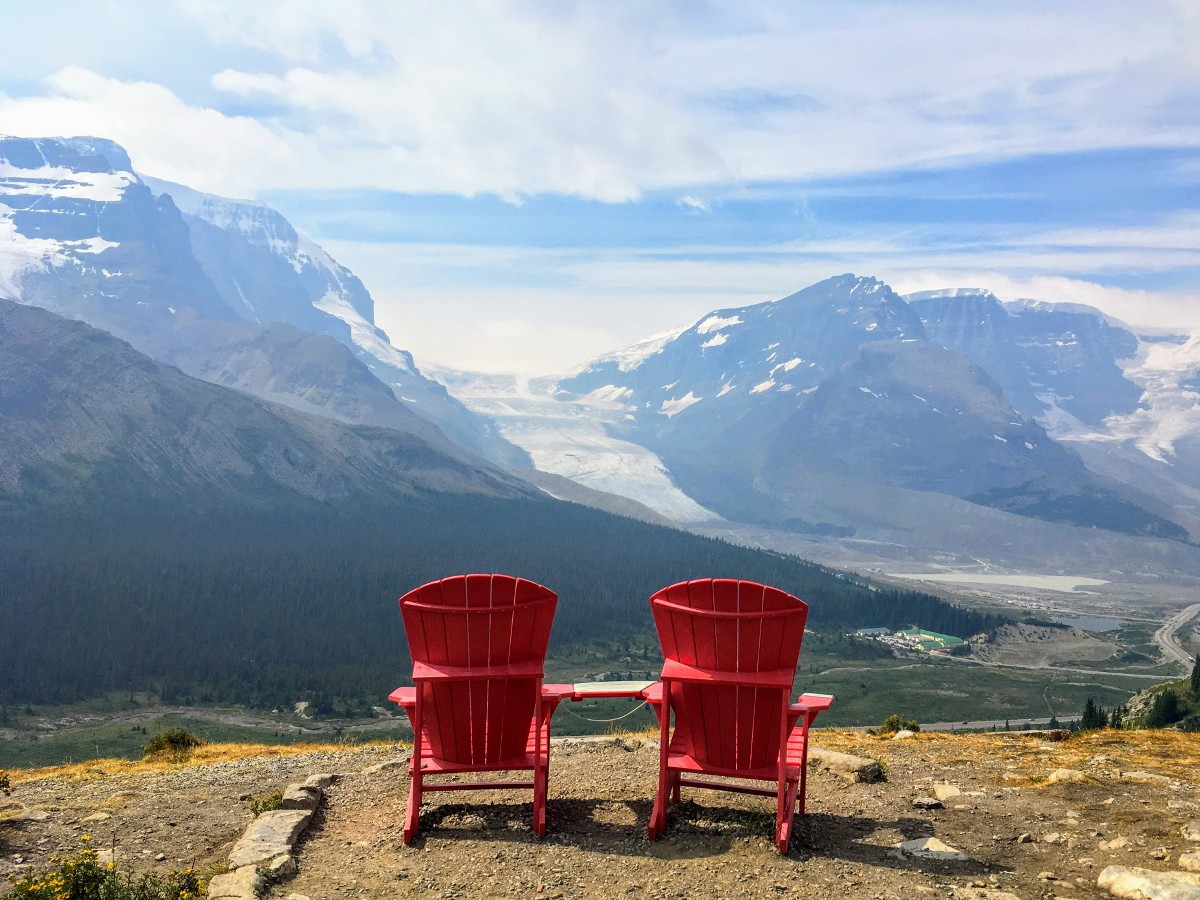 Red chairs and Athabasca glacier