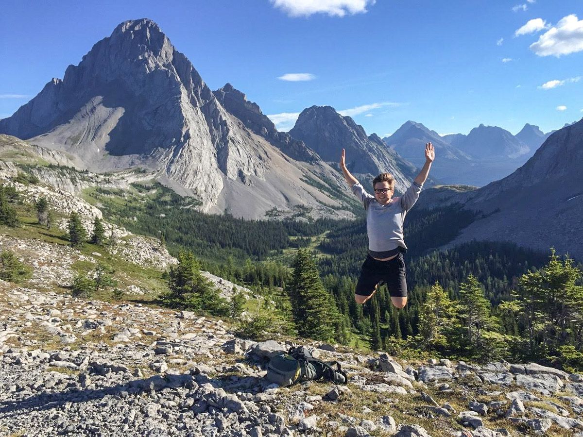 Happy guy hiking to Burstall Pass in Canmore