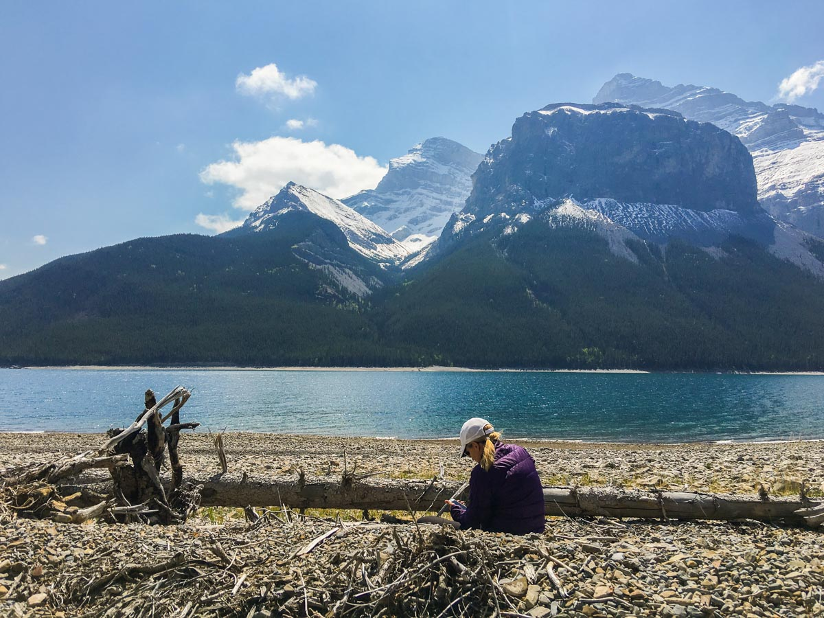 Beautiful spot for lunch on Lake Minnewanka backpacking trail in Banff National Park