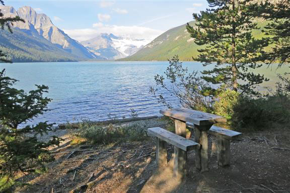Bench near the lake on Glacier Lake Backpacking trail in Banff National Park