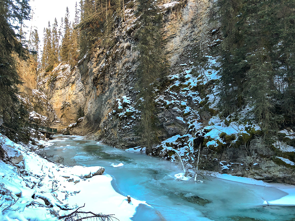 Beautiful color of the water and ice on Johnston Canyon snowshoe trail in Banff National Park