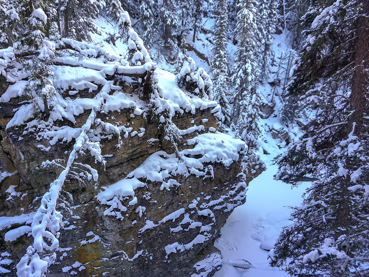 Approaching the Lower Falls on Johnston Canyon snowshoe trail in Banff National Park
