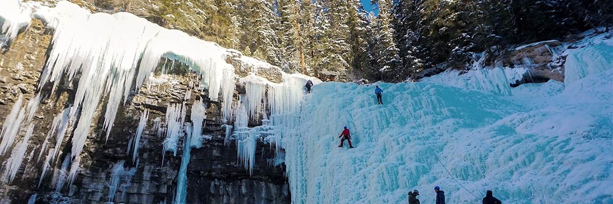 Ice Climbing on Johnston Canyon snowshoe trail in Banff National Park