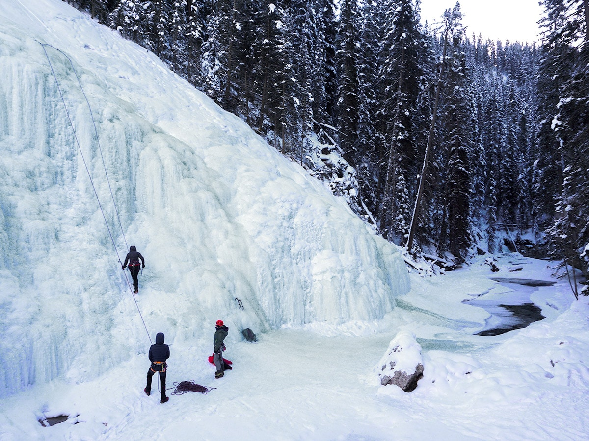 Ice Climbers on Johnston Canyon snowshoe trail in Banff National Park