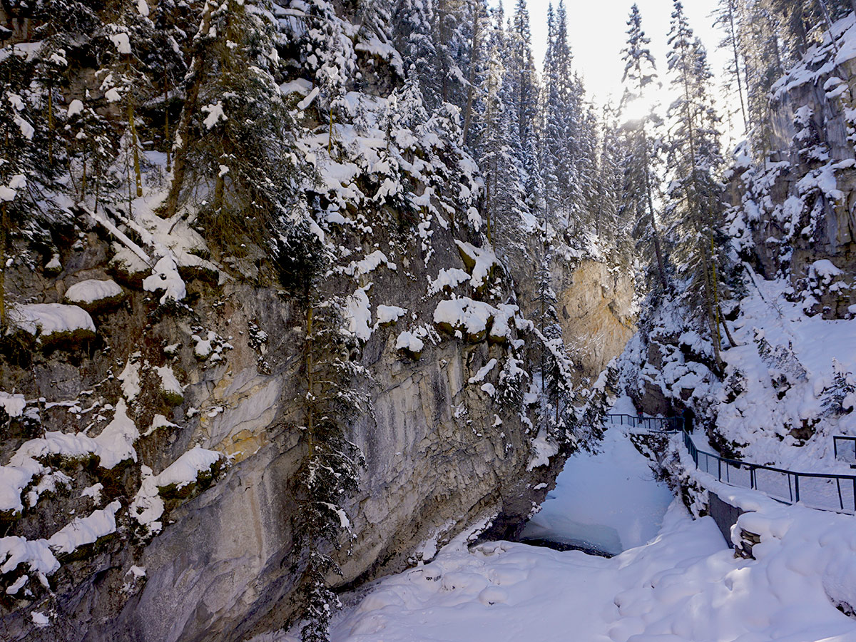 Winter hiking on ice on Johnston Canyon snowshoe trail in Banff National Park