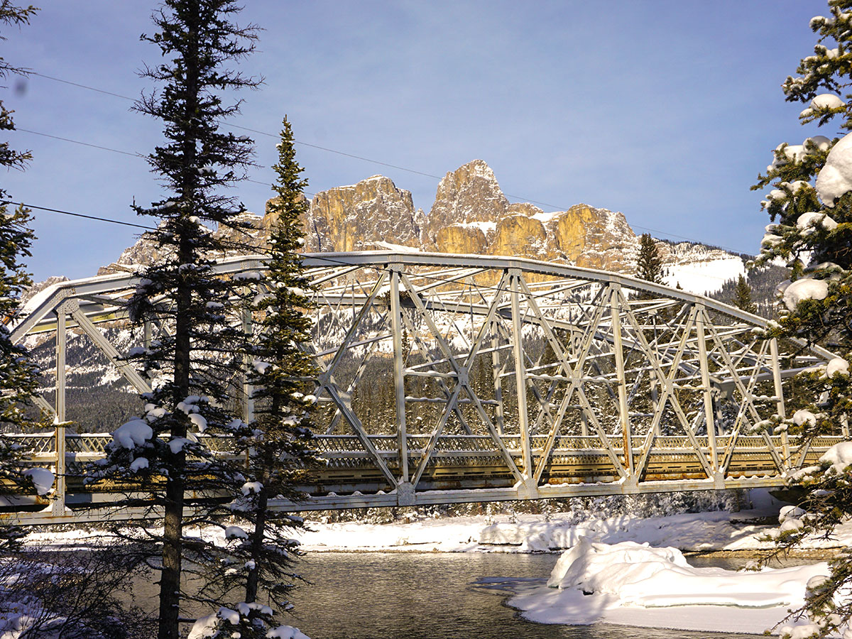 The bridge at Castle Junction on Johnston Canyon snowshoe trail in Banff National Park
