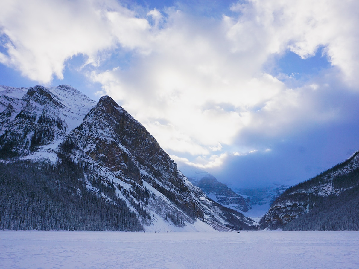 Snowy mountains around Lake Louise snowshoe trail in Banff National Park