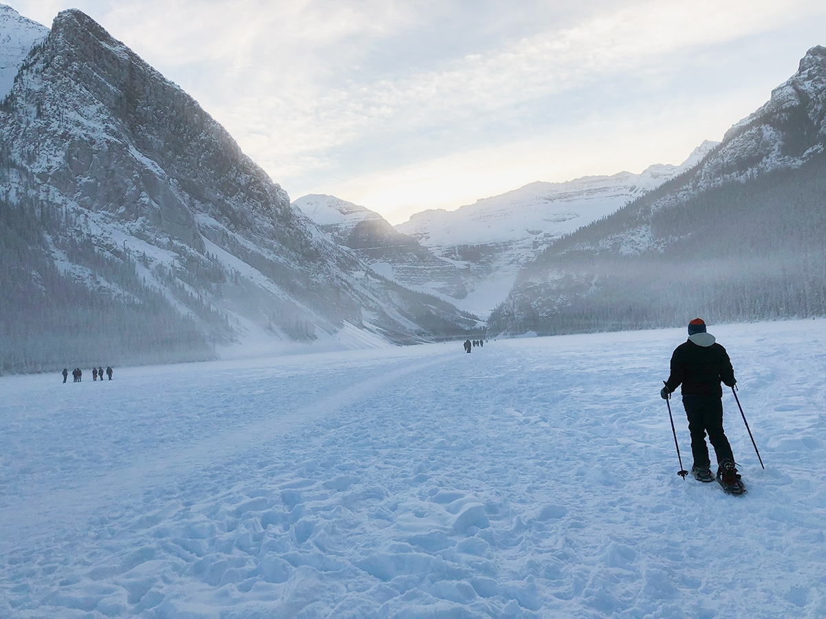 People on Lake Louise snowshoe trail in Banff National Park
