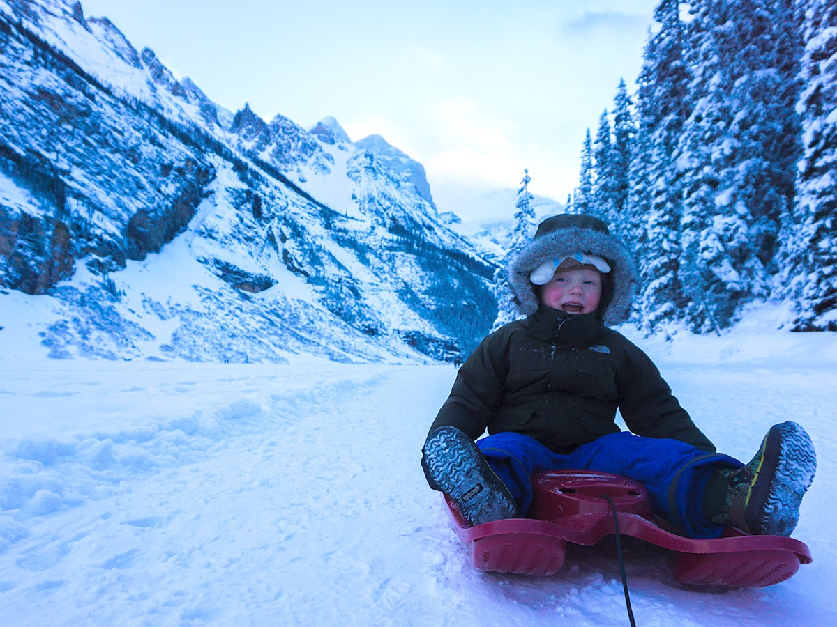 Sleigh ride on Lake Louise snowshoe trail in Banff National Park