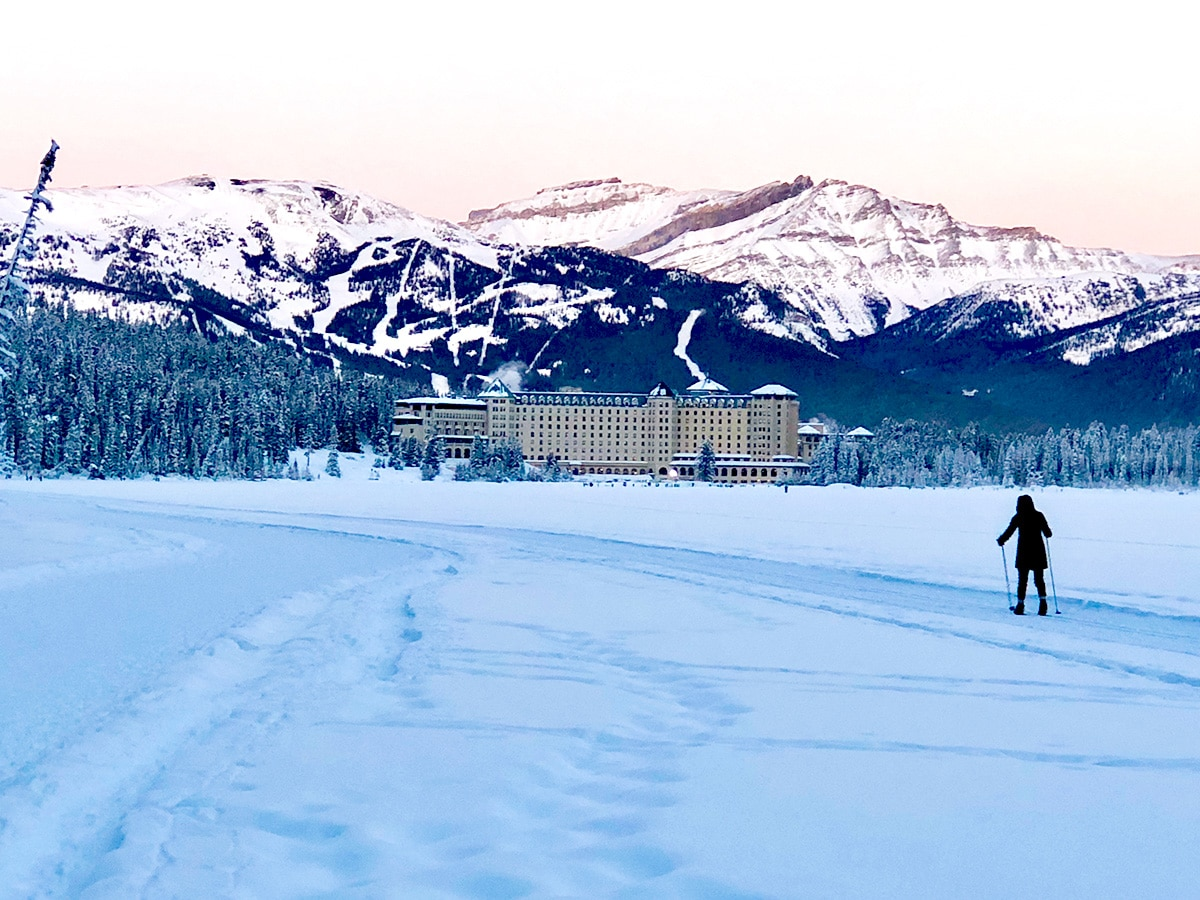 Cross country skier on Lake Louise snowshoe trail in Banff National Park