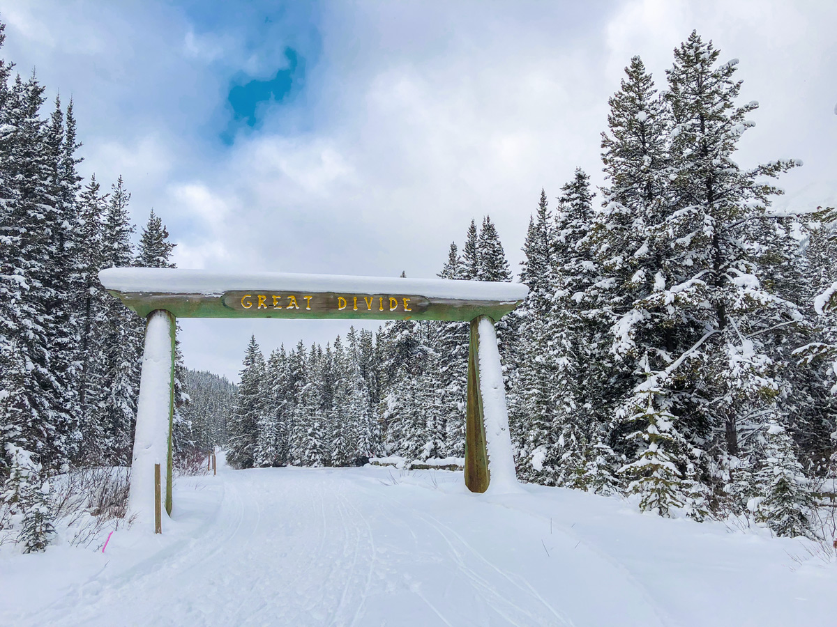 Passing the sing on Great Divide 1A XC ski trail in Lake Louise, Banff National Park
