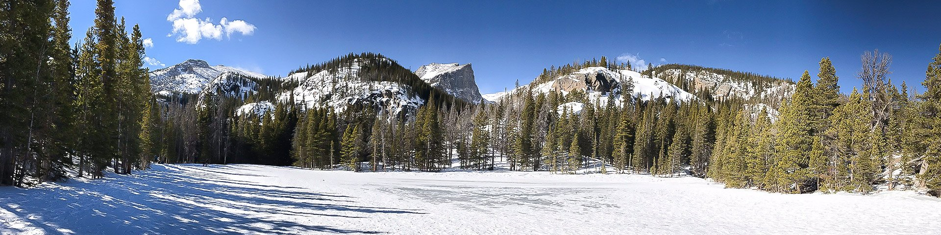 Panorama of Nymph Lake snowshoe trail in Rocky Mountain National Park, Colorado