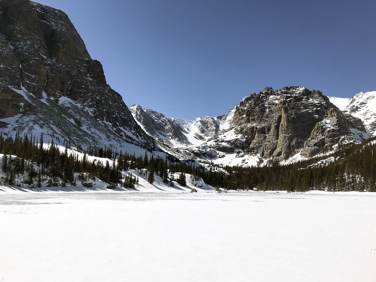 Frozen Lake on The Loch snowshoe trail in Rocky Mountain National Park, Colorado