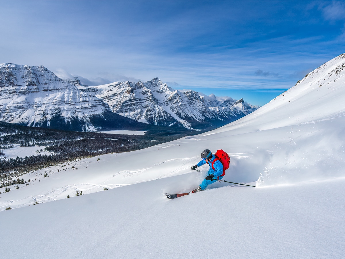 Man skiing on a trail in the Canadian Rockies