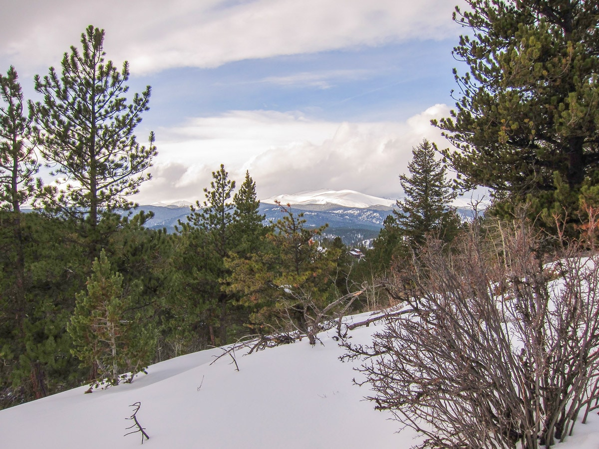 Hiking during winter on Dot snowshoe trail in Indian Peaks, Colorado