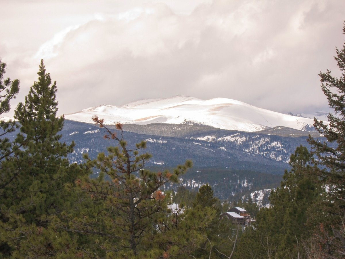 Snowy mountain top on Dot snowshoe trail in Indian Peaks, Colorado