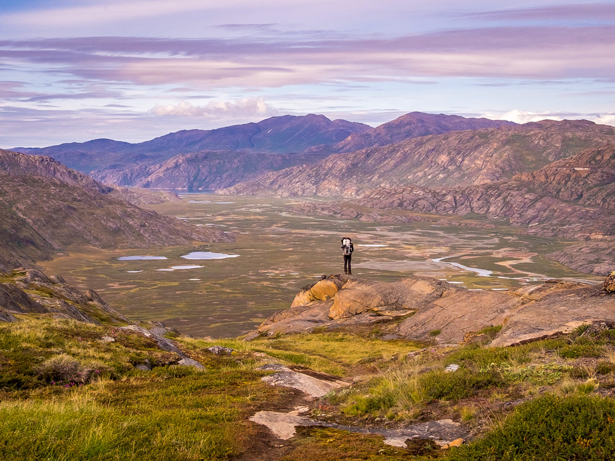 Hiker and valley views on Arctic Circle Trail hike
