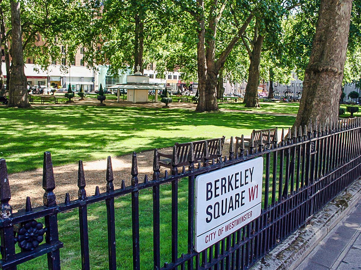 Relaxing Berkeley Square in Mayfair while on city-walk in London, England, UK