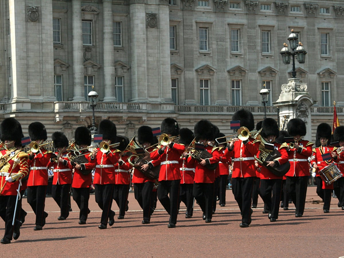 Guards Marching outside of Buckingham Palace on St. James, Green, Hyde and Kensington parks walking tour in London, England