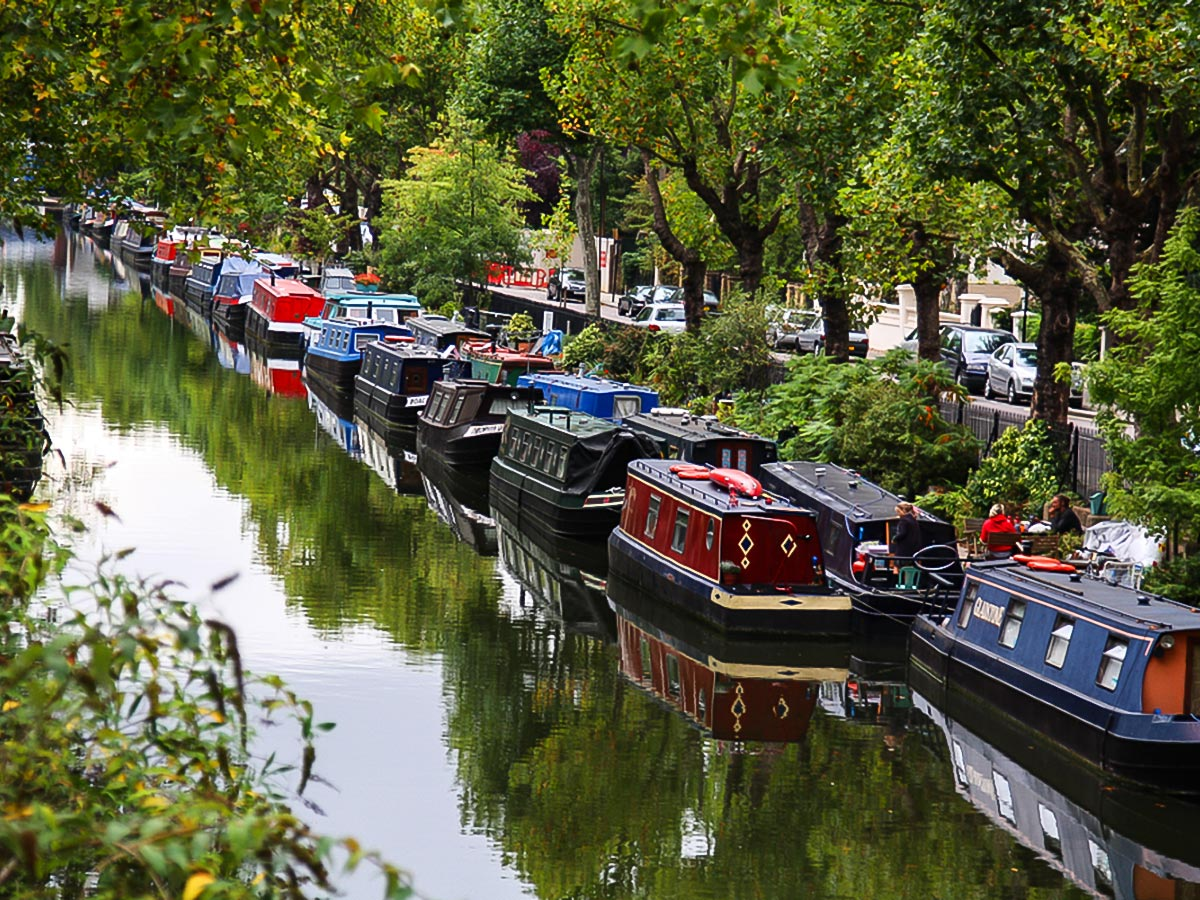 Houseboats along the canal on Regent's Canal from Edgware Road to Camden Town walking tour in London, England