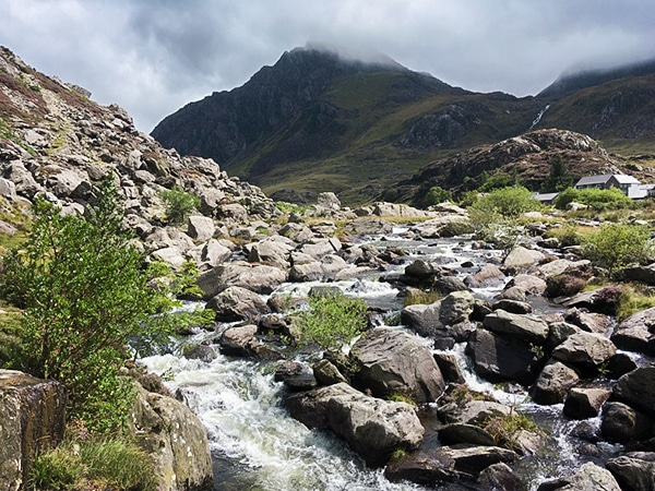 Hiking Towards the lake of Llyn Idwal in the Glyderau mountains