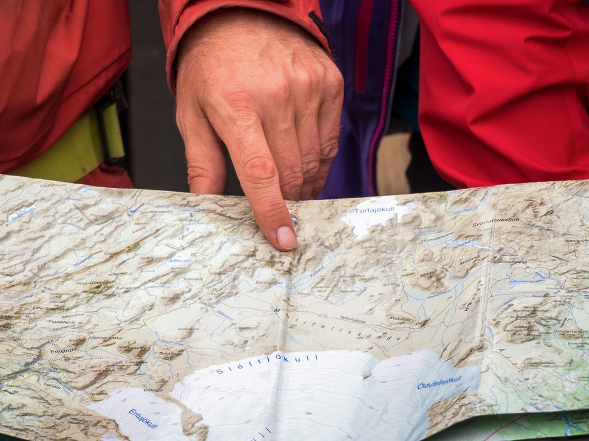 Lisa Germany using the paper map on a trek