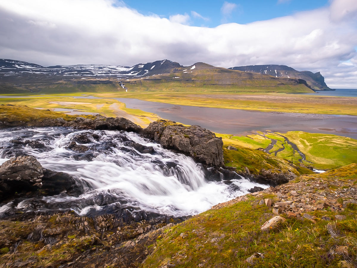 Waterfall and a large river on Iceland's Hornstrandir Nature Reserve trek