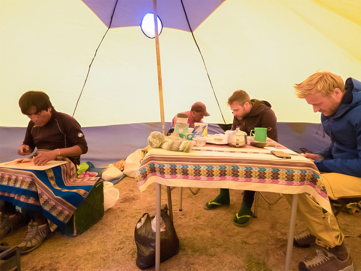 Huayhuash Staying warm and journaling inside the cook tent