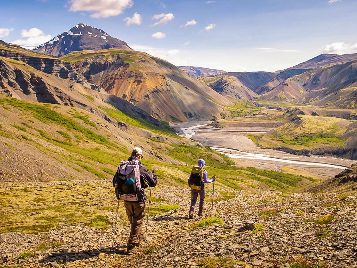 Hikers approaching the river on Iceland's Shadow of Vatnajökull Trek