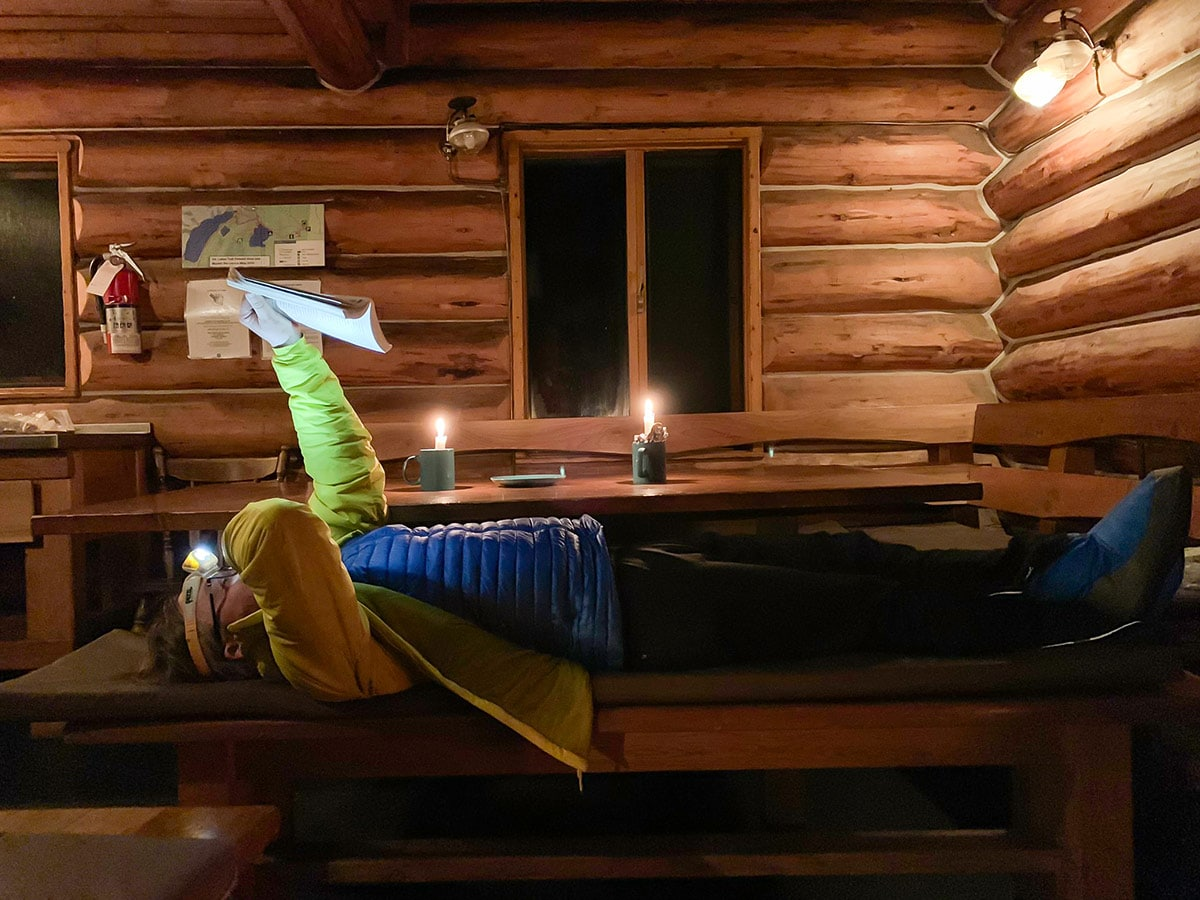 Reading at Elk Lakes Cabin on Elk Lakes Backcountry Skiing Adventure