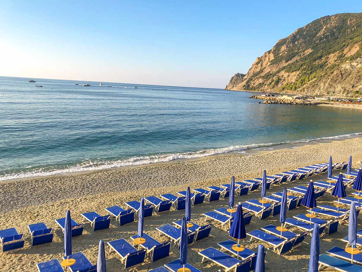 Beautiful beach in one of small Italian villages along Cinque Terre hike in Liguria