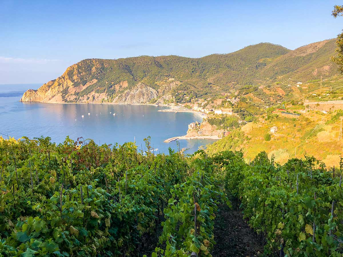 Small bay and beautiful Italian villages along the coast of Cinque Terre hike in Liguria, Italy