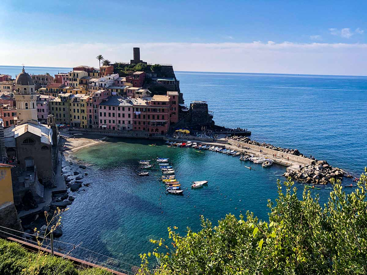 Vernazza and boats in the cove on Cinque Terre hike in Liguria, Italy