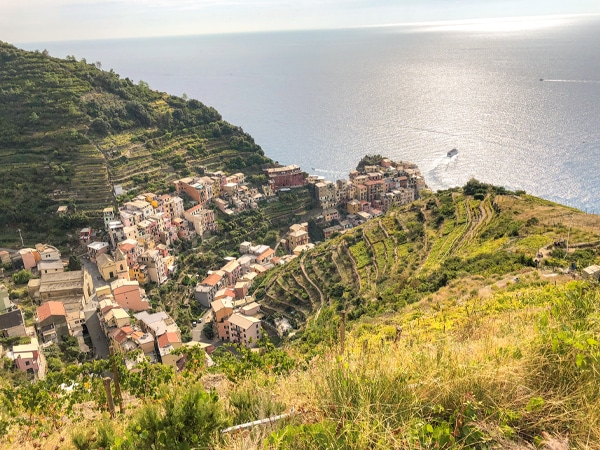 Beautiful view of the sea and village below on Cinque Terre trail in Liguria, Italy