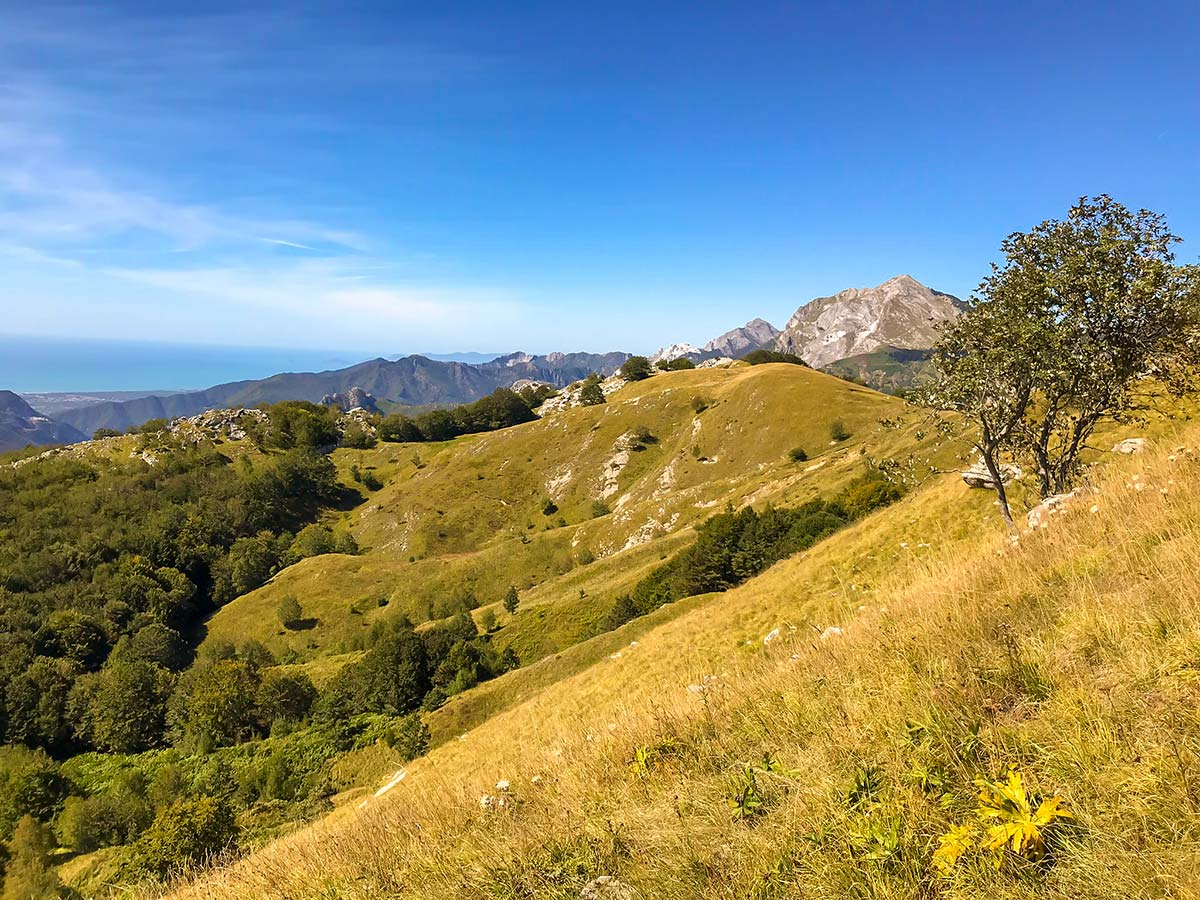 Beautiful mountains and sea in the distance on Monte Croce from Palagnana Hike in Tuscany