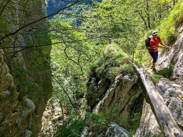Hiker and chains of Monte Croce from Palagnana Hike in Tuscany