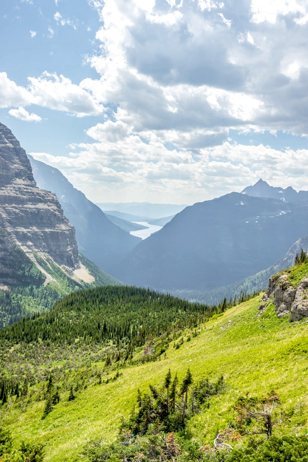 Beautiful Montana mountains and lake in the distance on Boulder Pass Backpacking Trail in Glacier National Park