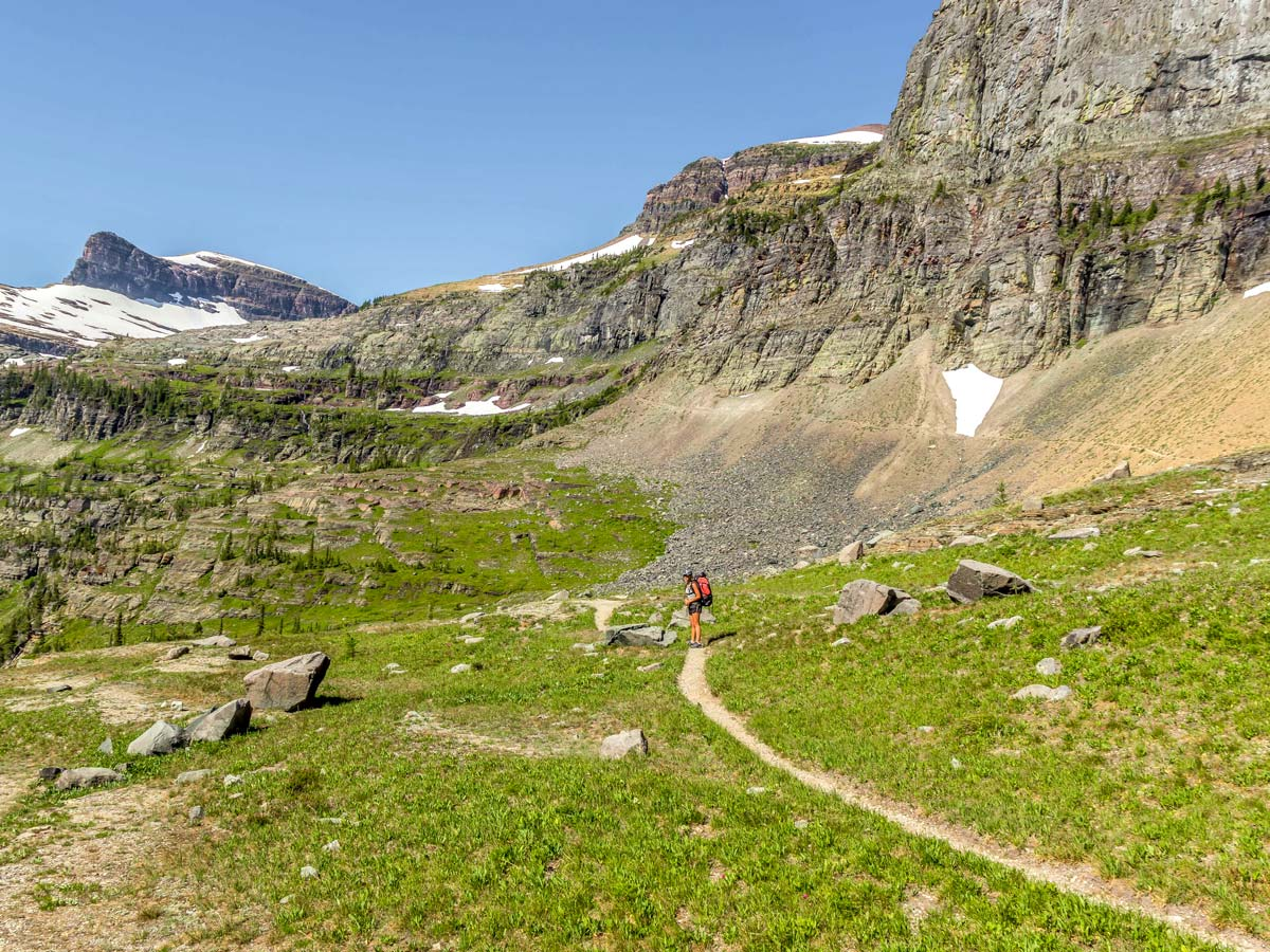 Happy backpacker on Boulder Pass Backpacking Trail in Glacier National Park