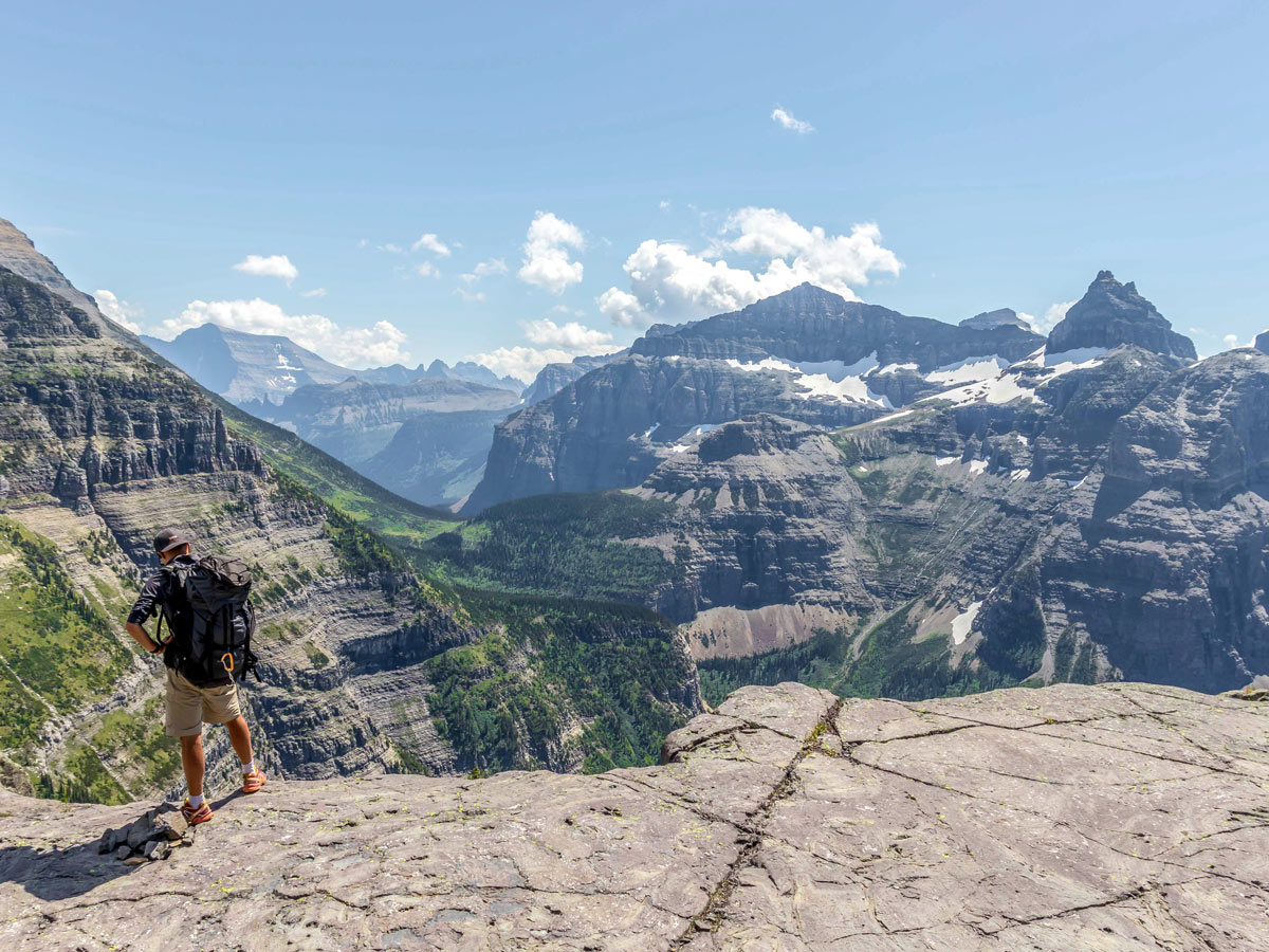 Hiker at amazing overlook on Boulder Pass Backpacking Trail in Glacier National Park