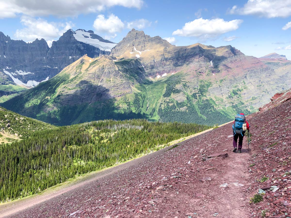 Backpacker surrounded by mountains on North Circle Backpacking Trail in Glacier National Park
