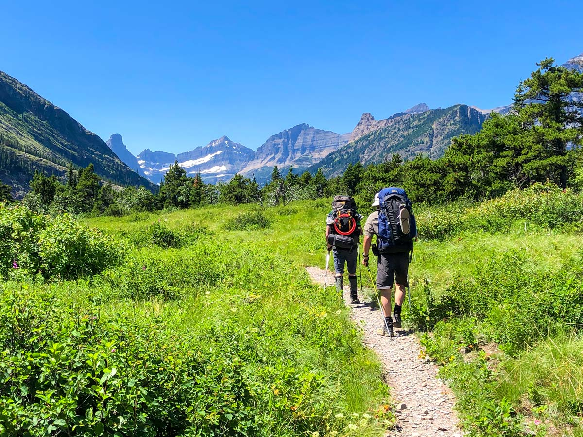 Couple backpacking on North Circle Backpacking Trail in Glacier National Park