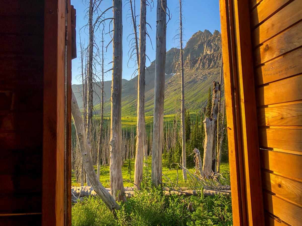 View from the prettiest outhouse on earth on North Circle Backpacking Trail in Glacier National Park